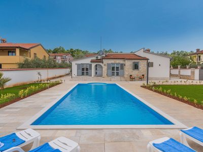 Photo for Nicely furnished villa with private pool, BBQ and fenced garden