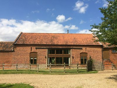 Photo for Spacious barn, countryside views, wood burner & private hot tub