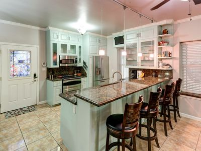 Photo for Contemporary condo with shared saltwater pool and great location!