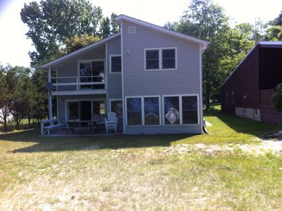 Photo for Beautiful lakefront 3BR house with 50' of PRIVATE SANDY BEACH!