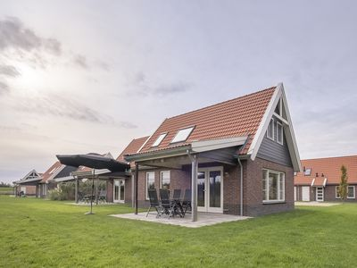 Photo for 4-person bungalow in the holiday park Landal Waterparc Veluwemeer - on the water/recreation lake