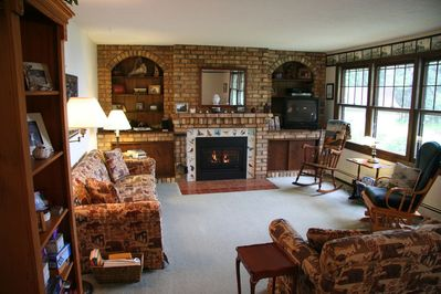 Enjoy an afternoon by the fire with lake views through the large picture windows