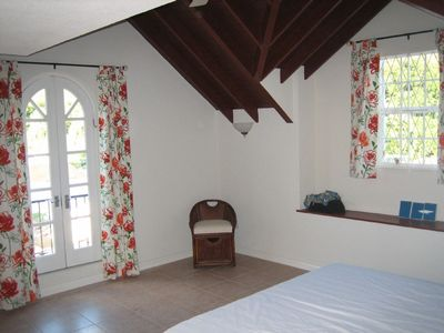 Master bedroom with king size bed and wardrobes