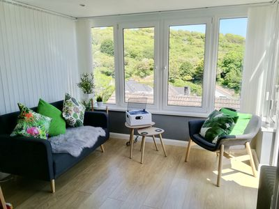 Photo for Gorgeous Sea and Mountain View Bespoke Interior Mumbles 2 Bed Holiday Bungalow