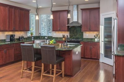 The huge gourmet kitchen is perfect for preparing meals with friends and family