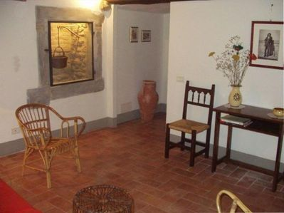 Living Room with Roman Well