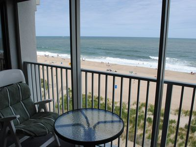 Photo for Spacious, comfortable 2 bedroom oceanfront condo with free WiFi, an outdoor pool, and an enclosed balcony with a great ocean view located midtown only steps to the beach!
