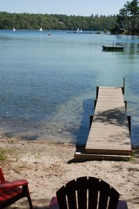The private beach has dock and floating raft.