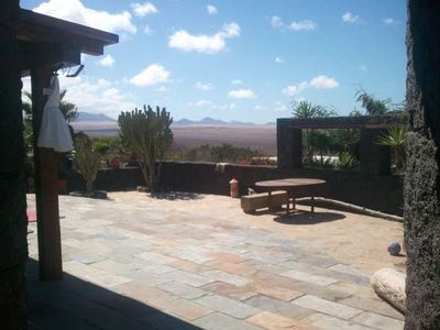Photo for Bungalow with pool BUNGIBOZ in Famara for 5 persons with pool, terrace, garden, views to the ocean, views of the volcanoes, WIFI and less than 200m to the sea