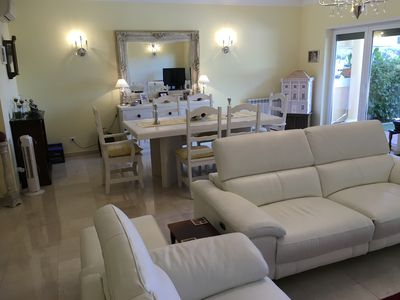 Lounge/Diner with direct access to Patio & Pool.