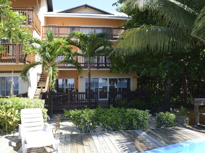 Photo for 3 bedroom Beach Front condo with pool West Bay Beach!