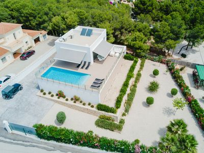 Photo for Modern villa in Ibiza style with breathtaking views of Moraira and the sea