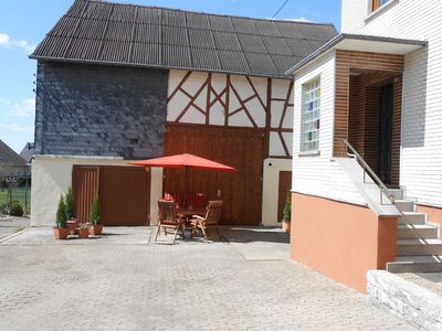 Photo for Detached former farmhouse with modern interior and private garden