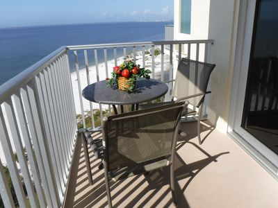 Dining table and chairs on the balcony.
