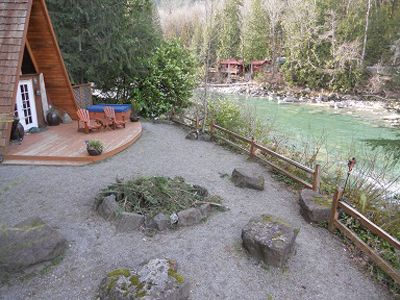 Fire pit, spa, adirondack chairs and Skykomish River