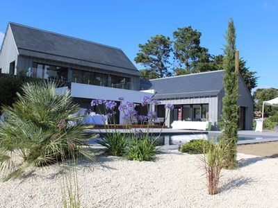Photo for CONTEMPORARY HOUSE WITH HEATED SWIMMING POOL 150M FROM THE BEACH- 14 PEOPLE