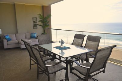 Spacious balcony with glass railings for unobstructed, spectacular views..