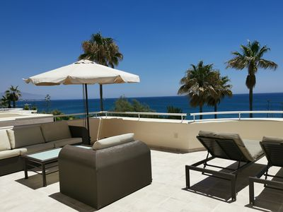 Photo for Direct access to the beach, pool, panoramic view, 100sqm terrace