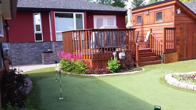 Photo for Quiet neighborhood, close to downtown, hot tub, chipping and putting green.