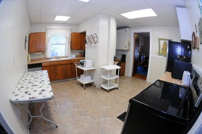 Large, open kitchen with carts that can be work tables, or used to transport.