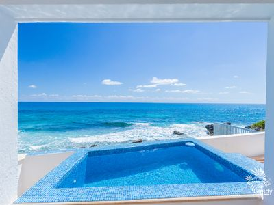 Photo for Caribbean Oceanfront 2 Bed/2 Bath Condo w/ Heated Private & Rooftop Pools