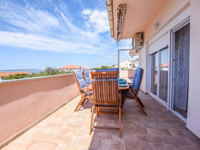 Photo for Two bedroom apartment with terrace and sea view Mandre, Pag (A-18239-b)