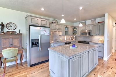The elegant kitchen and large marble-topped island provides everything you'll need to whip up a delicious meal.