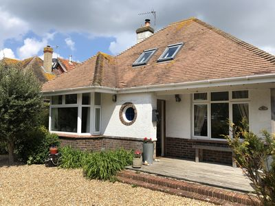Photo for Seaside cottage style home with pool, large garden, log burner