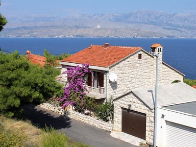 Photo for Three bedroom apartment with terrace and sea view Postira, Brač (A-2909-a)