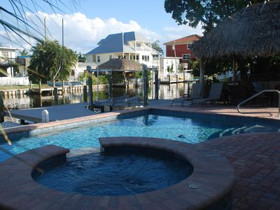 "Photo for Canal, Pool, Hot Tub and Tiki on canal - welcome to our ""Sun Kissed Cottage"""