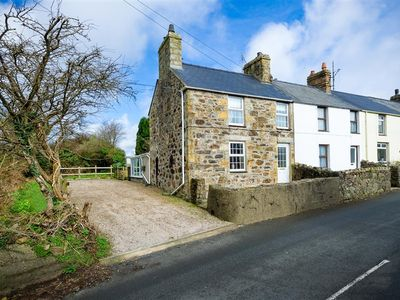 Photo for In the quaint village of Llanbedrog, within easy reach of Abersoch and Pwllheli, is this delightful