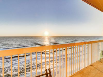 Photo for Cool & comfortable beachfront condo w/ a private balcony, shared pool, & gym