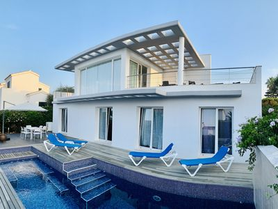 Photo for Modern luxury villa with pool and stunning sea views.