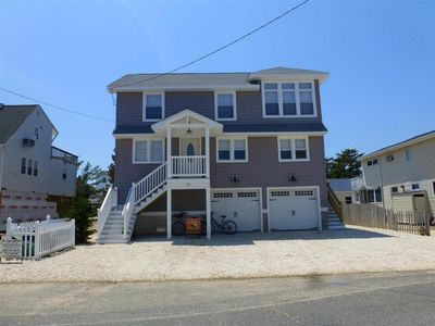 Photo for Enjoy evening sunsets over the bay from this newly renovated  2fl duplex in Brant Beach.  140096