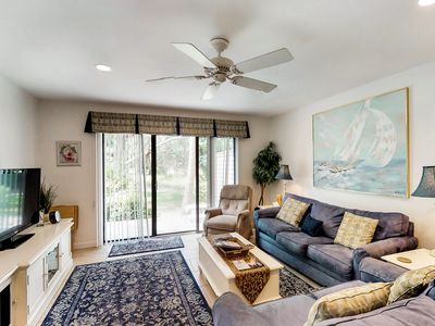 Photo for Dog-friendly townhouse w/shared pool, golf course view, and beach access