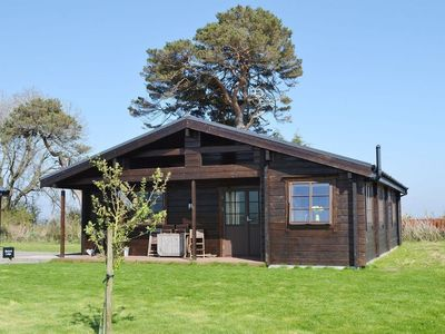 Photo for Skylark Lodge - A Fabulous and very comfortable seaside log chalet, a minutes walk from the beach an