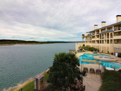 Photo for Lake front and upscale condo w/ shared pool, hot tub, sauna, and tennis courts!