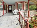 Porch - Relax with friends on the classic Southern front porch.