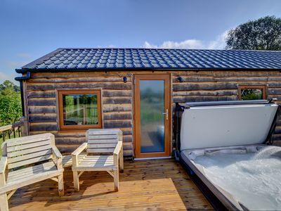 Photo for The dark sky status of this area of Radnorshire, and the private hot tub set into the decking of Lov