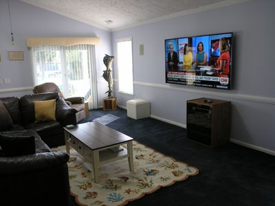 """Great room with 75"""" LED television"""