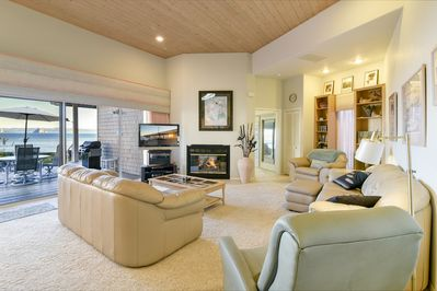 The living room has it all - views, fireplace, big-scrn TV, comfortable seating.