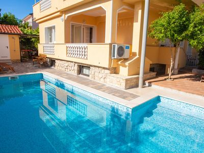 Photo for Holiday apartment with air conditioning and pool use