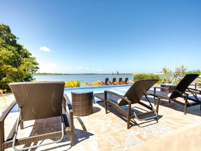 Photo for Lagoon-front lounging at this private villa!