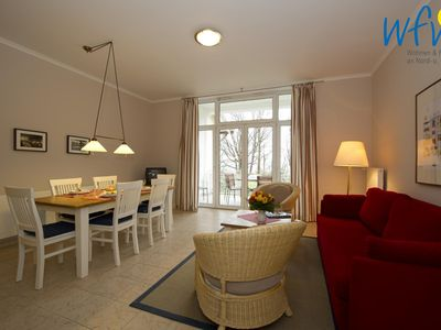 Photo for Apartment with sunny south-facing terrace, fireplace and sea view!