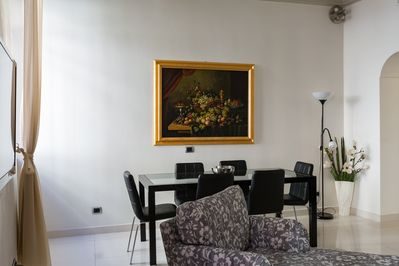 Gracious and bright, the living/dining room has two large windows.
