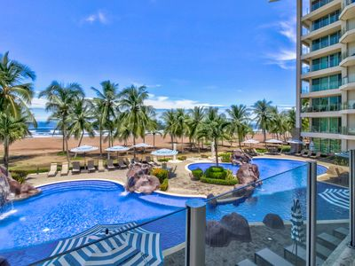 Photo for Modern, oceanfront condo with ocean and pool views, easy beach access!