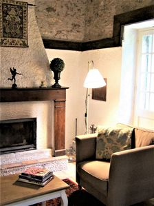 Stay cosy and comfy by the wood-burning fireplace in your stone cottage