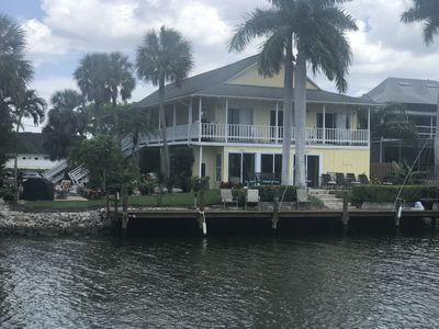 Photo for Waterfront, balcony, 3 houses from ocean, gran kitchen, dock, 1.5 mi from beach