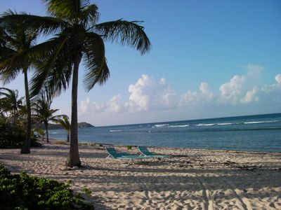 Photo for 2 Bed/2 Bath Beachfront Condo with Caribbean view and gorgeous pool.