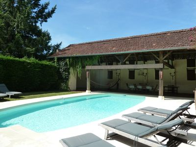 Photo for Charming farmhouse with pool in the heart of Perigord near Dordogne river
